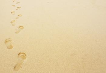 Fototapeta footprints in the sand background