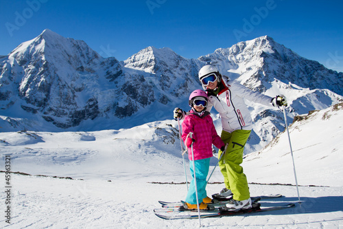Fotobehang Wintersporten Skiing, winter sports - skiers on mountainside