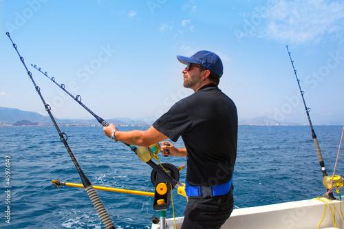 Fotografie, Obraz  blue sea fisherman in trolling boat with downrigger