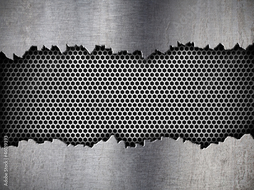 Fotografia silver hexagon metal grate background in ripped hole