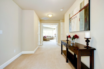 Large home hallway with art and furniture.