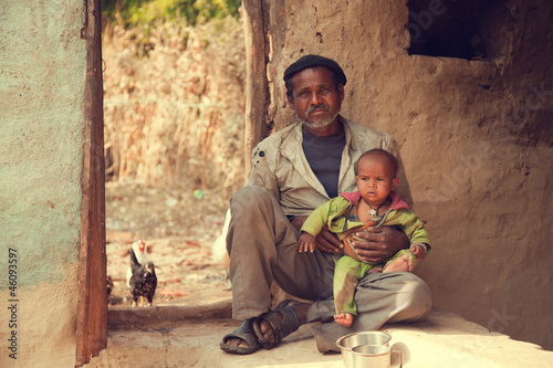 Fotografie, Obraz  Indian poor father and son