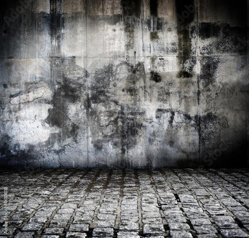 Obraz na plátne Fond rue en pavé et mur abimé