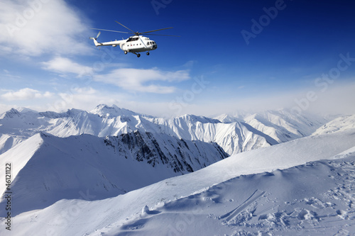 Poster Helicopter Heliski in snowy mountains