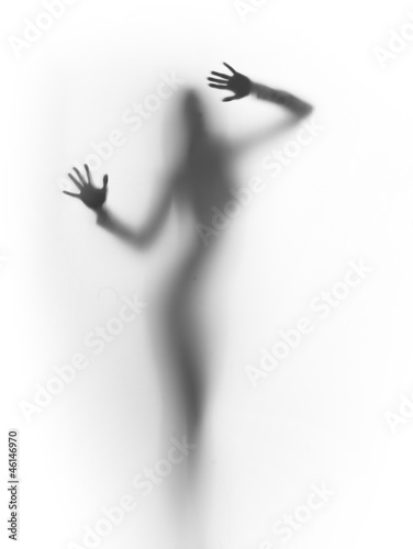 Fototapety, obrazy: diffuse silhouette of a slim lady, behind a glass surface
