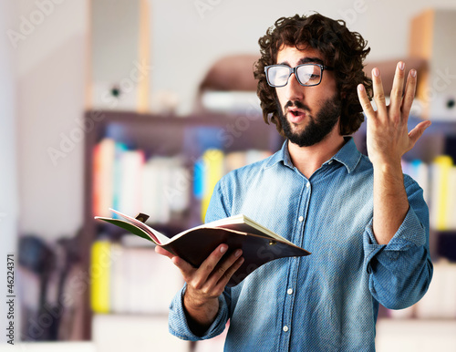 Portrait Of Man Reading Book Fototapete