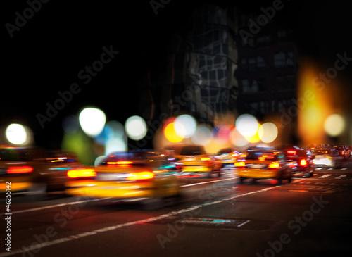 Foto op Plexiglas New York TAXI Blurred yellow cabs