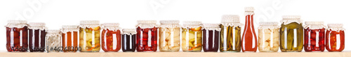 Photo  Long line of various preserves on a shelf