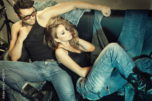 Fotografie, Obraz  Sexy man and woman dressed in jeans doing a fashion photo shoot