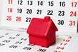 Leinwandbild Motiv Miniature House on Calendar Pages