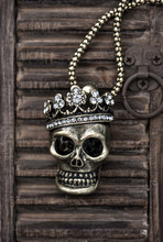 Skull With Crown On Wooden Background