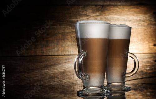 Fotografie, Obraz  Fragrant coffee latte in glass cups on wooden  background