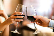 Male And Female Hands Toasting...
