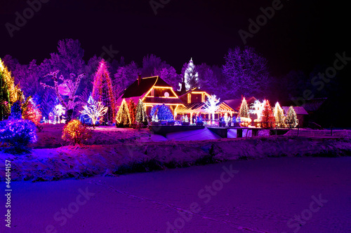 Spoed Foto op Canvas Violet Christmas fantasy - park, forest & lodge in xmas lights