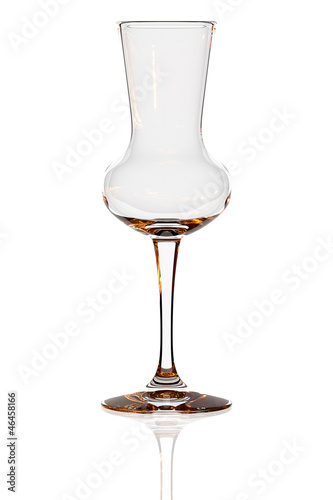Empty grappa glass isolated on white Canvas Print