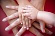 Leinwandbild Motiv Family hands on team