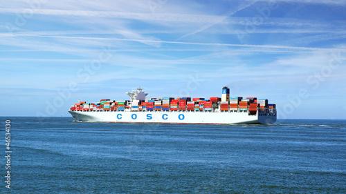 Fotografie, Obraz Container Ship COSCO with full of cargo. Rotterdam