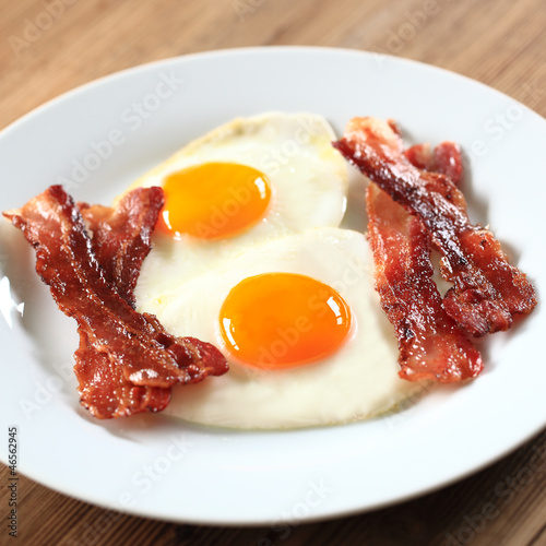 Fotobehang Gebakken Eieren Spiegeleier mit Bacon
