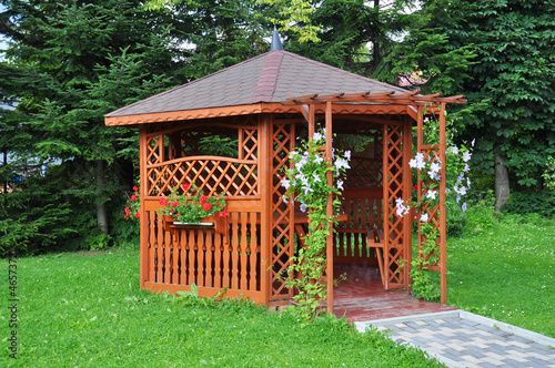 Obraz Gazebo in the garden - wooden house - fototapety do salonu