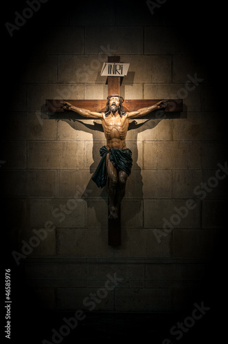 Obraz na płótnie Crucifix in church on the stone wall.