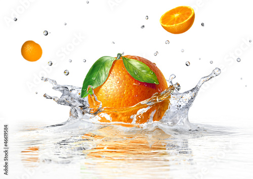 orange splashing into clear water