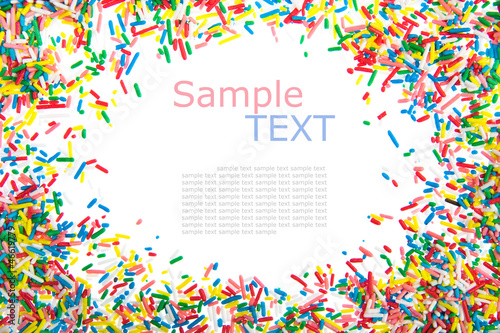 Photo  Frame made of little colorful sprinkles candy isolated on white
