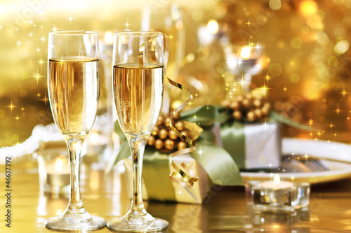 Fotografie, Obraz  Two champagne glasses on the dinner table