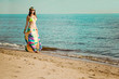 Luxurious beautiful fashionable woman on the beach