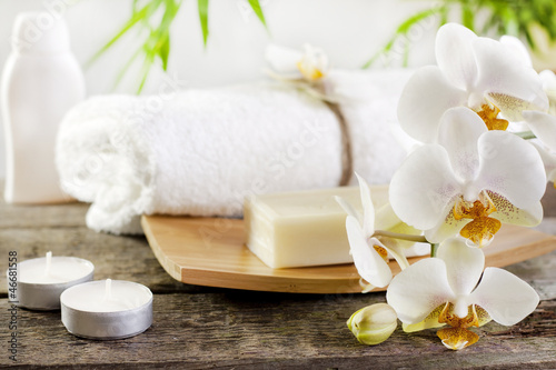 Orchids spa soap and towel concept on wooden boards