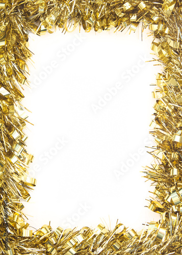 gold christmas tinsel forming border on white background buy this