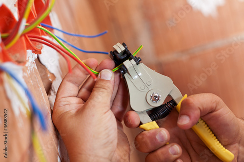 Photo  Electrician peeling off wires