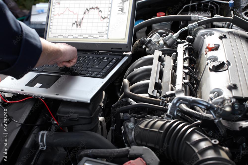 Obraz Car mechanic working in auto repair service. fototapeta, plakat