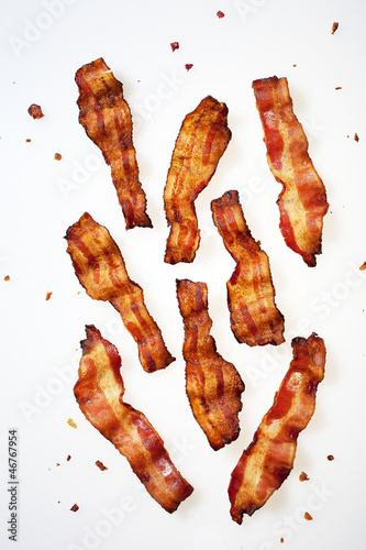Photo Strips of Bacon Displayed on White