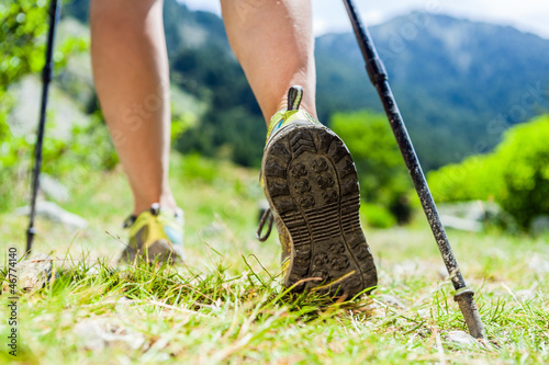 Fotografia  Nordic walking legs in mountains