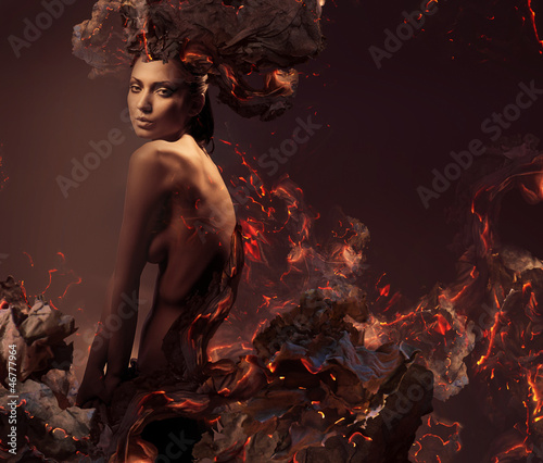 sexy attractive nude woman in burning ashes