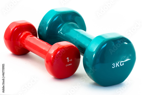 Fotografia  Blue and red fitness dumbbells isolated on white background