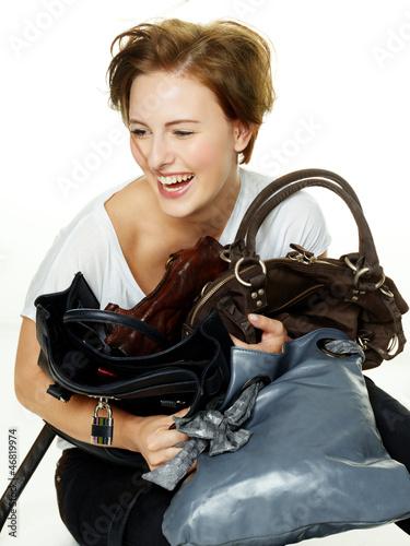 Fotografie, Obraz  Woman has fun to adhere her bags
