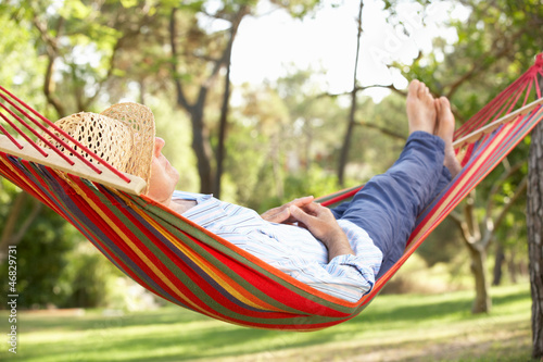 Fotografie, Obraz  Senior Man Relaxing In Hammock
