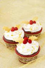Christmas Cupcakes With Gold Leaves And Red Berries