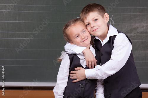 Fotobehang womenART Portrait of schoolchildren near a blackboard