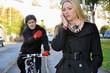 Leinwandbild Motiv Junge Frau telefoniert auf Fahrradweg