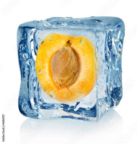 Staande foto In het ijs Ice cube and apricot