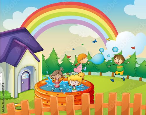 In de dag Regenboog a house and kids