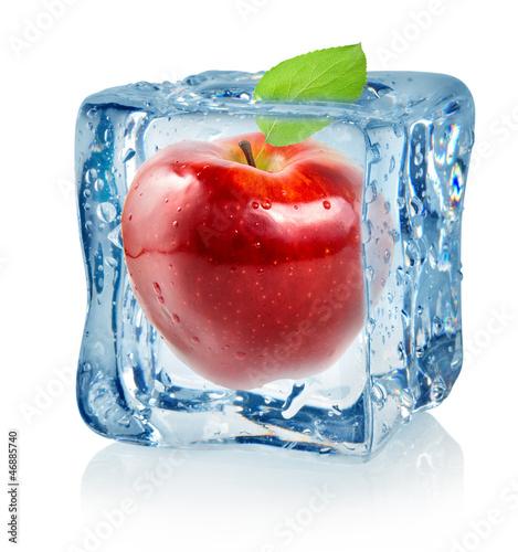 Staande foto In het ijs Ice cube and red apple