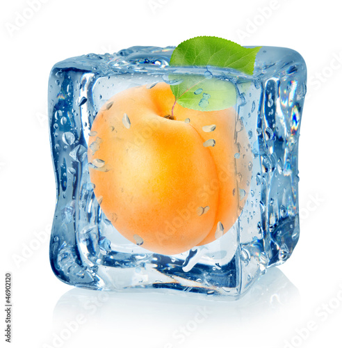 Staande foto In het ijs Ice cube and apricot isolated