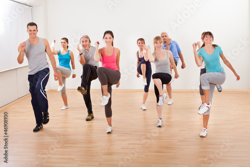 Fotografie, Obraz  Group of people doing aerobics exercises