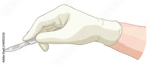 Fotografia The hand holds a scalpel.