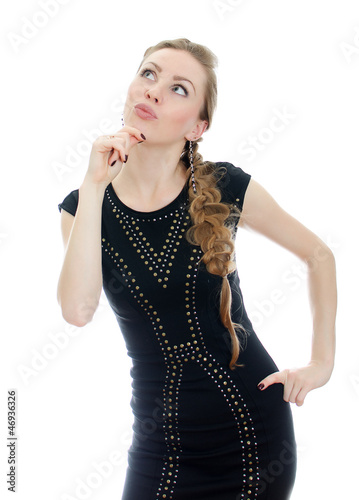 Fotografia, Obraz  Woman with pigtail in black dress thinking. Isolated on white.
