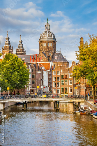 Ingelijste posters Amsterdam Canal and St. Nicolas Church in Amsterdam