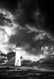 Lighthouse with approaching dramatic storm clouds